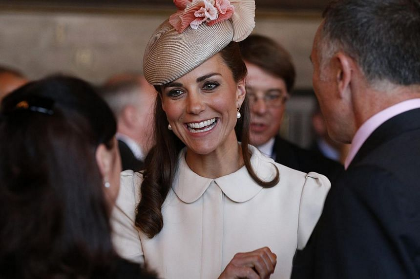 Catherine, Duchess of Cambridge attends a reception at the town hall in Mons on Aug 4, 2014. -- PHOTO: REUTERS