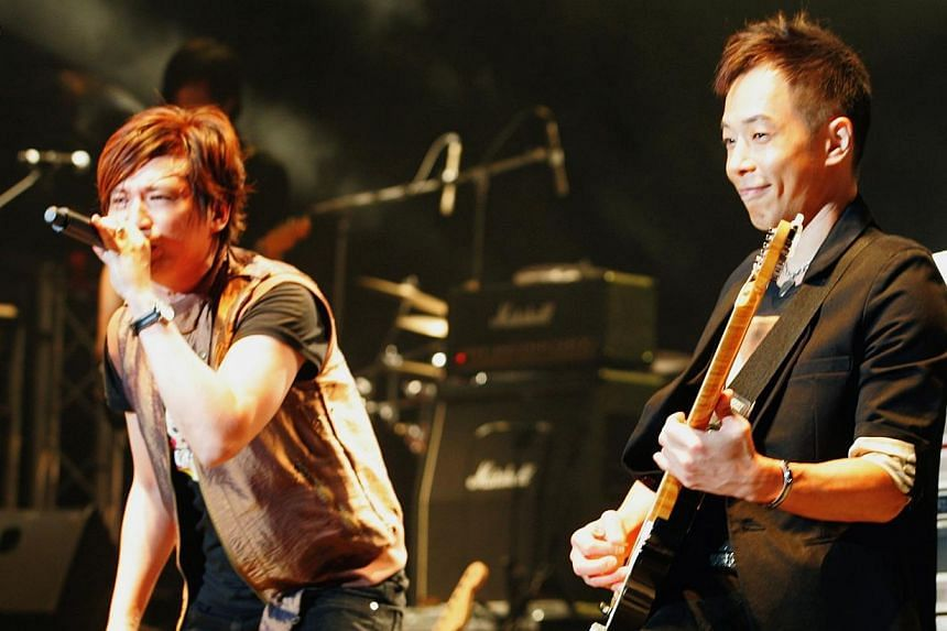 Yip Sai Wing (left) and Paul Wong of former Hong Kong band Beyond performing at the Singapore Indoor Stadium. -- PHOTO: LIANHE ZAOBAO FILE