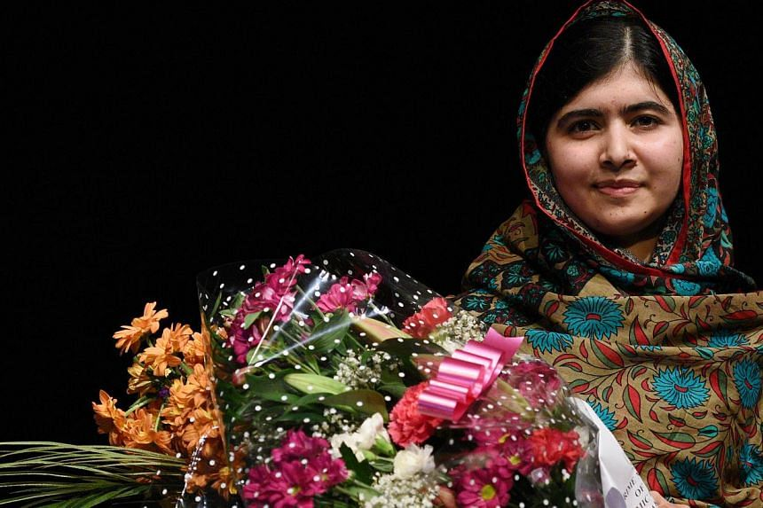 Pakistani rights activist Malala Yousafzai poses for a photograph after addressing the media in Birmingham, central England on Oct 10, 2014. -- PHOTO: AFP