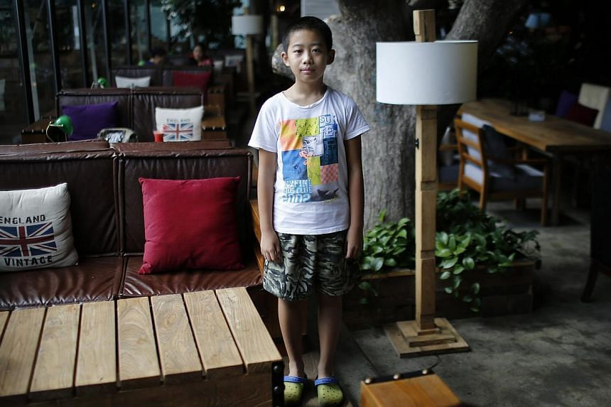 "2005: Qian Dingheng: ""I don't want [a sibling], because he would interrupt my homework."" -- PHOTO: REUTERS"