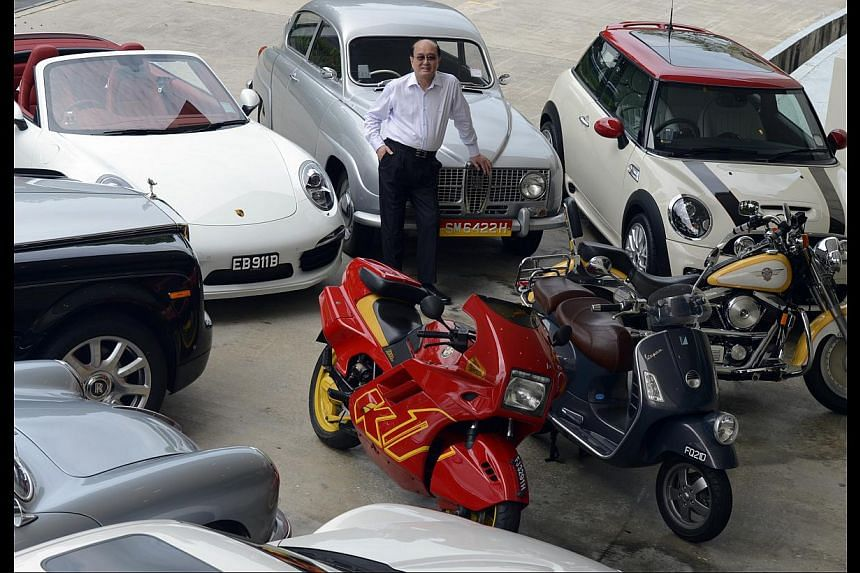 Mr Karsono Kwee's collection includes a few Porsches, a 1964 Rolls-Royce Silver Cloud, a 1967 Saab 9-2 and three bikes. -- ST PHOTO: DESMOND FOO