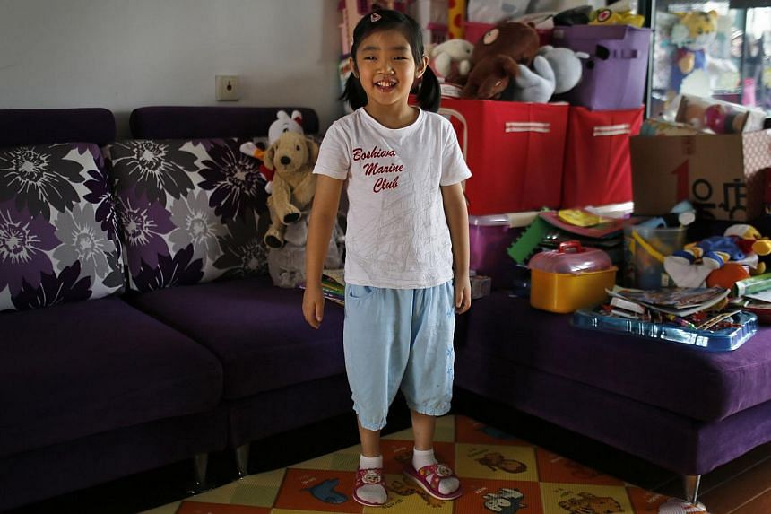 "2009: Dominating the living room in little Liu Ziyu's home is a big pile of toys. When asked if she would like to have siblings, Ziyu said that she didn't want any ""because my mother would pay full attention to him or her""."