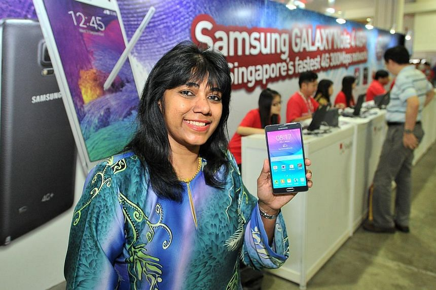 Madam Zahra Aspar started queueing from 7am for Samsung's Galaxy Note 4 at the launch event at Marina Bay Sands yesterday. She got the phone for the stylus pen and its wide selfie feature.