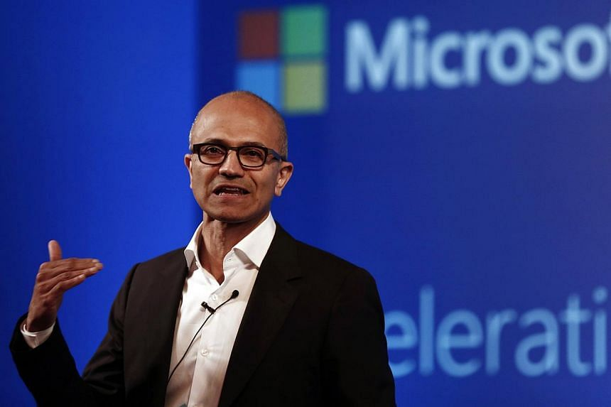 "Microsoft chief Satya Nadella addresses the media during an event in New Delhi on Sept 30, 2014. Nadella sparked a furore on Thursday when he suggested women in tech shouldn't ask for pay raises but should instead trust the system and rely on ""karma"""