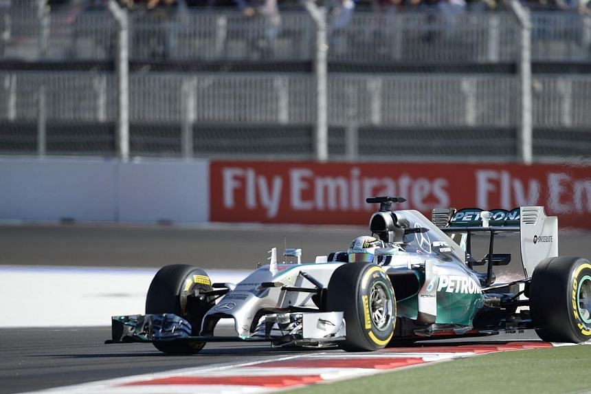 Mercedes' British driver Lewis Hamilton drives during the qualifying session of the inaugural Russian Grand Prix at the Sochi Autodrom in Sochi on Oct 11, 2014. -- PHOTO: AFP