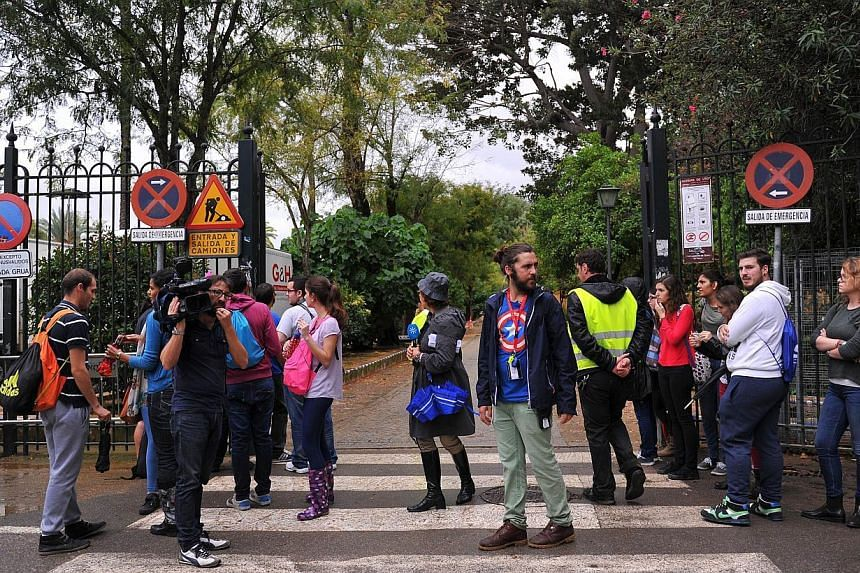 Fans and media stand at the entrance to one of the sets for the fifth season of the series Game Of Thrones at the Reales Alcazares (Royal Palace) in Sevilla on Oct 10, 2014. Film crews began shooting part of the fifth season of popular US fantasy tel