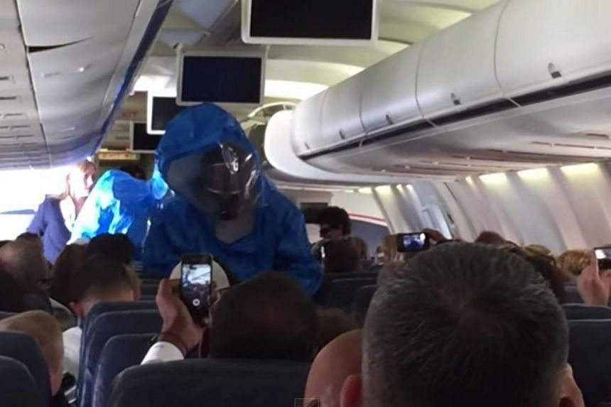 A screenshot from a video on YouTube that has been viewed more than two million times of a hazmat team boardingUS Airways Flight 845 from Philadelphia to the Dominican Republic tourist resort of Punta Cana on Wednesday after a passenger reporte