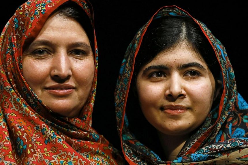Pakistani schoolgirl Malala Yousafzai (right), the joint winner of the Nobel Peace Prize, stands with her mother Torpekai after speaking at Birmingham library in Birmingham, central England Oct 10, 2014. Pakistani teenager Malala, who was shot in the
