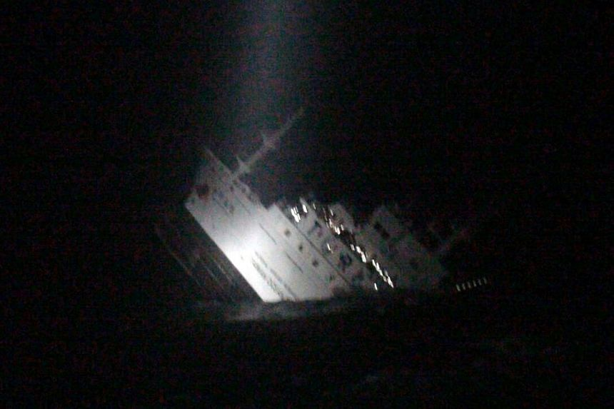 A video-grabbed image released by Taiwan's Coast Guard on Oct 11, 2014, shows the sinking marine research ship in the waters near the Penghu islands.-- PHOTO:AFP/TAIWAN COAST GUARD