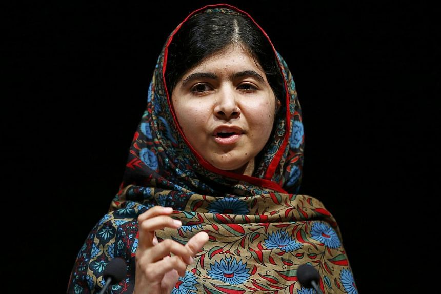 """Pakistani schoolgirl Malala Yousafzai, the joint winner of the Nobel Peace Prize, speaks at Birmingham library in Birmingham, central England Oct 10, 2014.Shesaid she was """"honoured"""" to be the first Pakistani and the youngest person to be"""