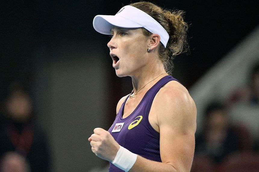 Samantha Stosur of Australia reacts after a point against Petra Kvitova of the Czech Republic during their women's singles semi-final match at the China Open tennis tournament in the National Tennis Center of Beijing on Oct 4, 2014. -- PHOTO: A