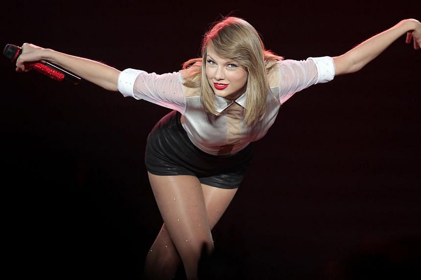 American pop star Taylor Swift performing at the Singapore Indoor Stadium on June 9 2014. Country-turned-pop singer Swift has been named Billboard's Woman of the Year becoming the first artist to win the honour more than once, the music industry trad