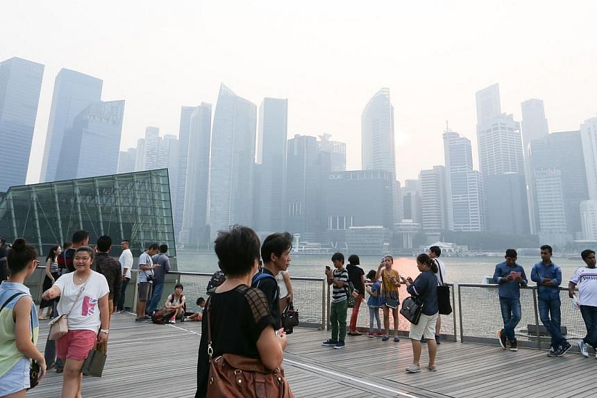 The Singapore skyline shrouded in haze on Oct 6, 2014. -- ST PHOTO FILE