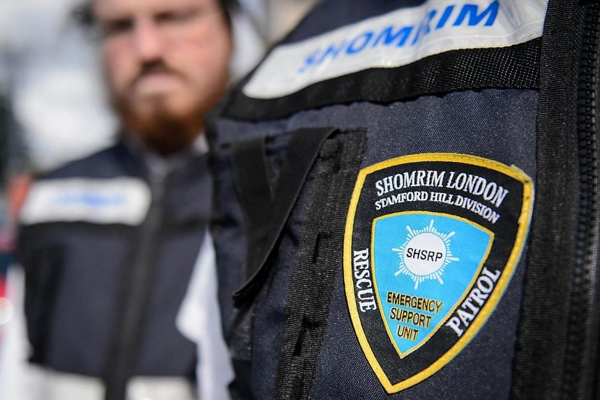 """Members of the Jewish """"Shomrim"""" security patrol team are pictured in north London on August 27, 2014. -- PHOTO: AFP"""