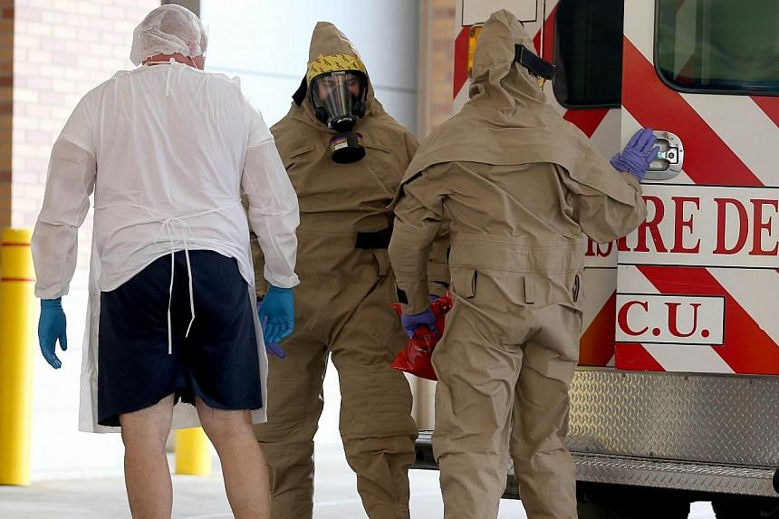 A possible Ebola patient is brought to the Texas Health Presbyterian Hospital on Oct 8, 2014 in Dallas, Texas. A health-care worker in Texas Health Presbyterian Hospital, who helped to treat a man who later died from Ebola, has tested positive for th