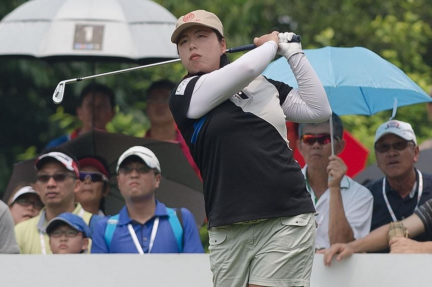 Feng Shanshan of China tees off on the 17th hole during the final round of the Sime Darby LPGA Malaysia 2014 tournament at the Kuala Lumpur Golf and Country Club in Kuala Lumpur on Oct 12, 2014. Feng ripped four birdies and an eagle through the
