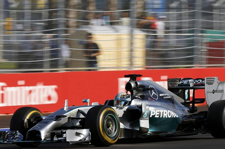Mercedes Formula One driver Lewis Hamilton of Britain speeds during the first Russian Grand Prix in Sochi on Oct 12, 2014. -- PHOTO: REUTERS