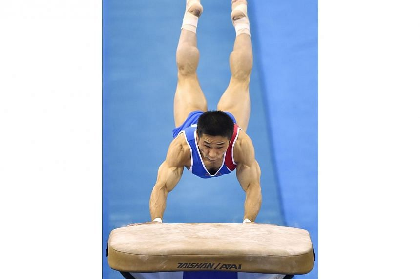 Ri Se Gwang of North Korea performs during the men's vault final at the gymnastics world championships in Nanning on Oct 12, 2014. The veteran Ri won his first global title on Sunday in the men's vault, as South Korea's defending champion and Ol