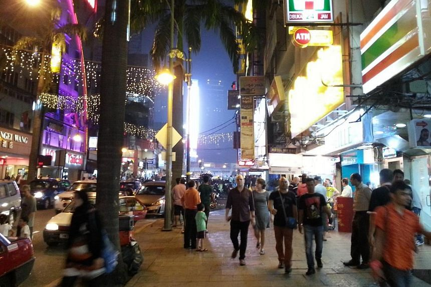 """Police have raided six nightclubs in Bukit Bintang as the hunt for """"Ah Hai"""", the suspected target in the grenade attack at Sun Complex on Oct 9, 2014, continues. -- ST PHOTO:TEO CHENG WEE"""