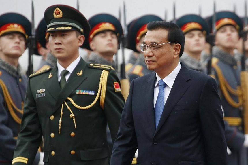 China's Prime Minister Li Keqiang (right) inspects the honour guard during a welcoming ceremony upon his arrival at Moscow's Vnukovo airport, Oct 12, 2014.Mr Li on Sunday arrived in Moscow for talks with President Vladimir Putin as Russia is st