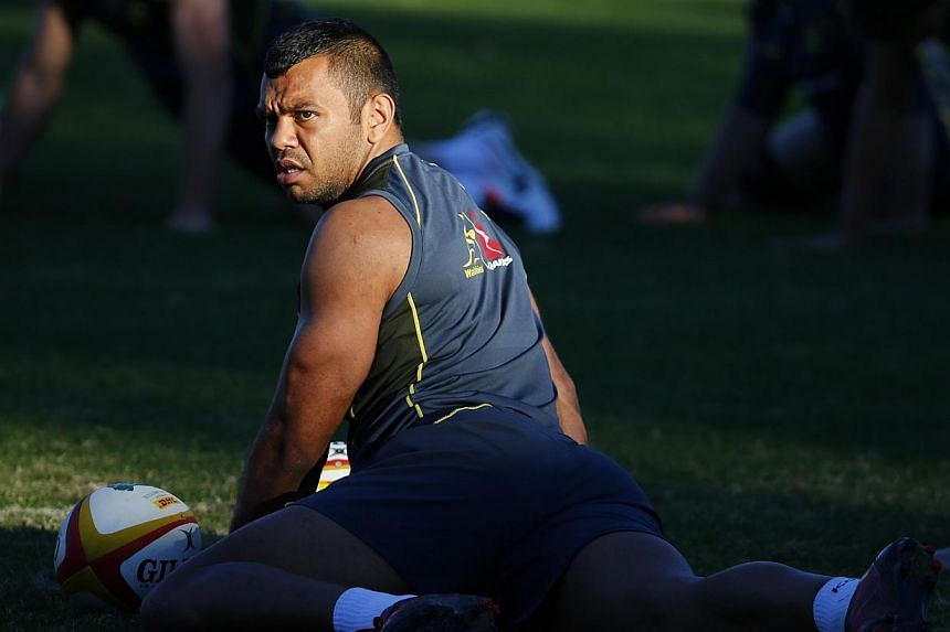 Australian rugby team player Kurtley Beale stretches during a training session in Sydney in this file picture taken on July 2, 2013.Wallabies captain Michael Hooper said on Sunday that Kurtley Beale should not be sacked and has called for a squ
