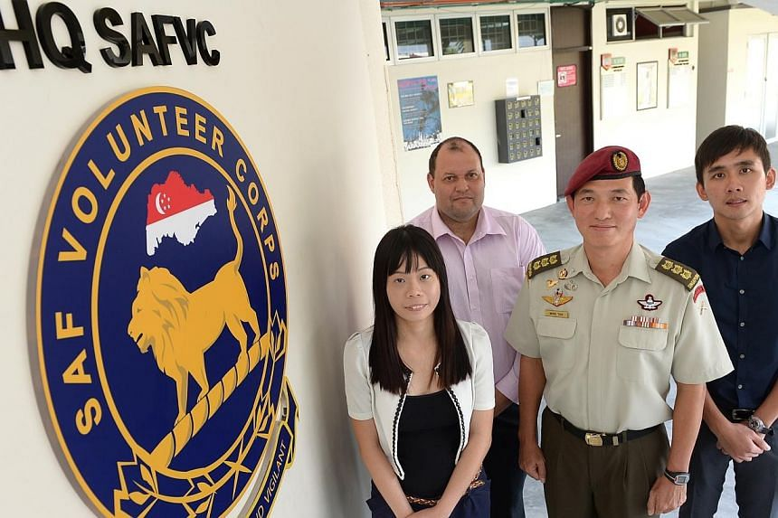 (From left) Singaporean Kweh Ting Ting, 27, Mr Calven Bland, 42, a New Zealand-born PR, Colonel Mike Tan, the appointed commander of the Singapore Armed Forces Volunteer Corps, and Mr Wong Weng Joon, 29, a Malaysia-born PR. Those who sign up for