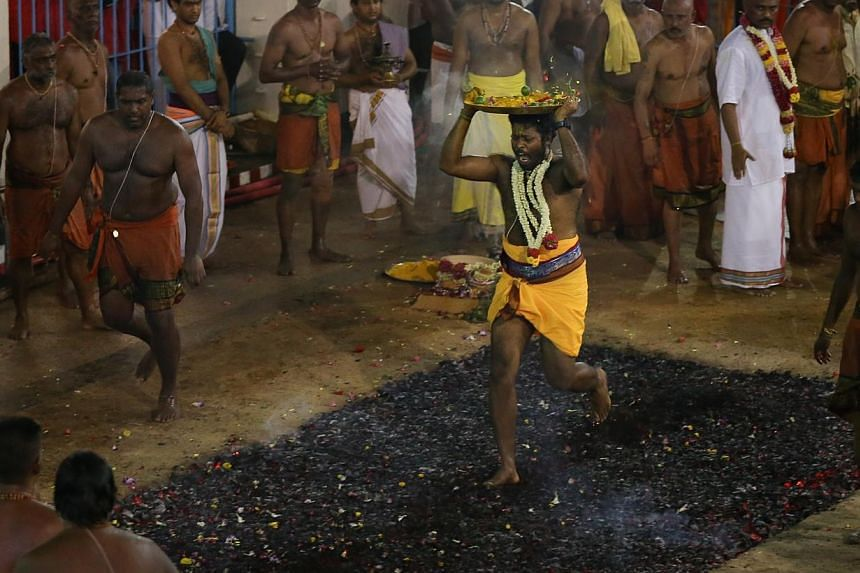 A Hindu devotee at the annual fire walking festival at Sri Mariamman Temple. -- ST PHOTO: ONG WEE JIN