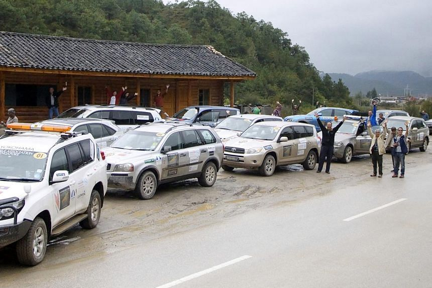The Automobile Association of Singapore's convoy at a rest stop on its way from Lijiang to Lugu Lake, Yunnan, in 2012.