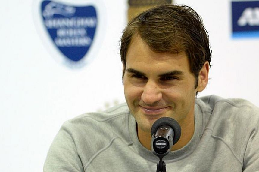 Roger Federer of Switzerland holds a press conference after his men's singles semi final match against Serbia's Novak Djokovic at the Shanghai Masters 1000 tennis tournament held in the Qizhong Tennis Stadium in Shanghai on Oct 11, 2014. -- PHOTO: AF
