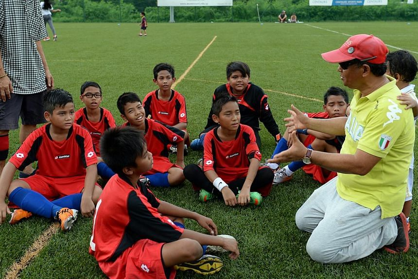 A football clinic in Jalan Kukoh in May 2014. -- PHOTO: BERITA HARIAN FILE