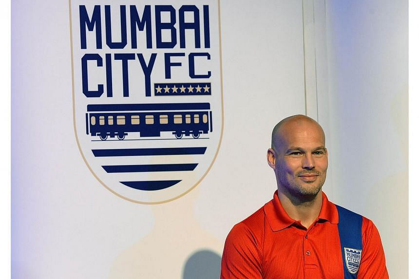 Mumbai City FC striker Fredrik Ljungberg attends the unveiling of the Indian Super League (ISL) football tournament trophy in Mumbai on Oct 5, 2014. India's ambitious new football league was dealt a blow ahead of its very first match when Ljungb