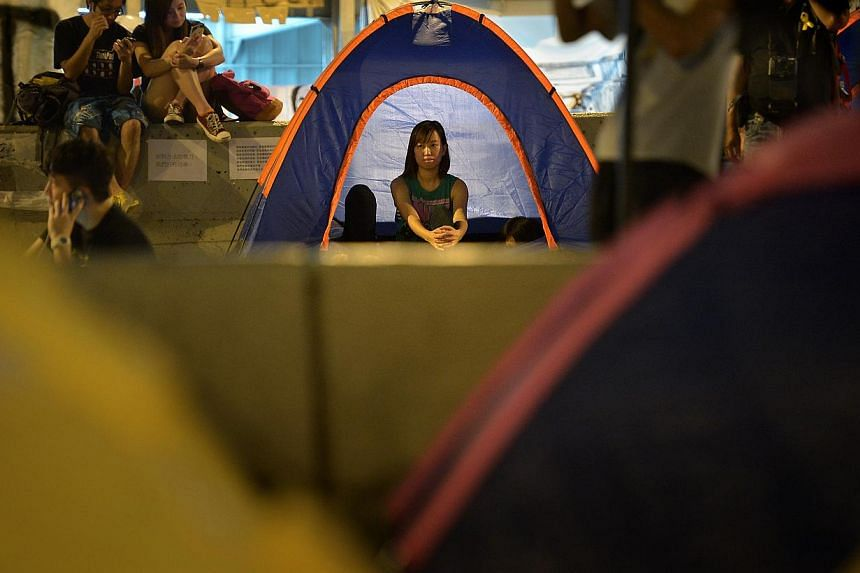 A lady sits in a tent along Harcourt Road in Admiralty, the main protest site in Hong Kong on Oct 11, 2014. -- ST PHOTO: KUA CHEE SIONG