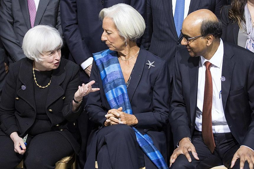 Deputy Prime Minister Tharman Shanmugaratnam - seen here (above) with US Federal Reserve chair Janet Yellen (left) and International Monetary Fund managing director Christine Lagarde - warned that aglobal economy still recovering from the finan