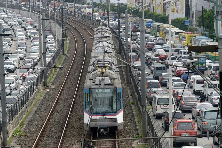 A major thoroughfare in the Manila is clogged with traffic on Sept 8, 2014, as an overhead trains whiz by in the centre lane. Manila already loses 2.4 billion pesos (S$68.4 million) in potential income daily due to traffic jams, according to a study