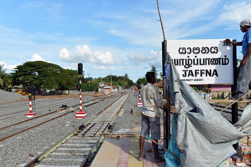 Sri Lankan construction labourers working at the Jaffna railway station on Oct 1, 2014. A railway in Sri Lanka that runs through minefields and snake-infested jungle is to reopen on Oct 13, 2014, nearly a quarter of a century after a bloody ethnic co
