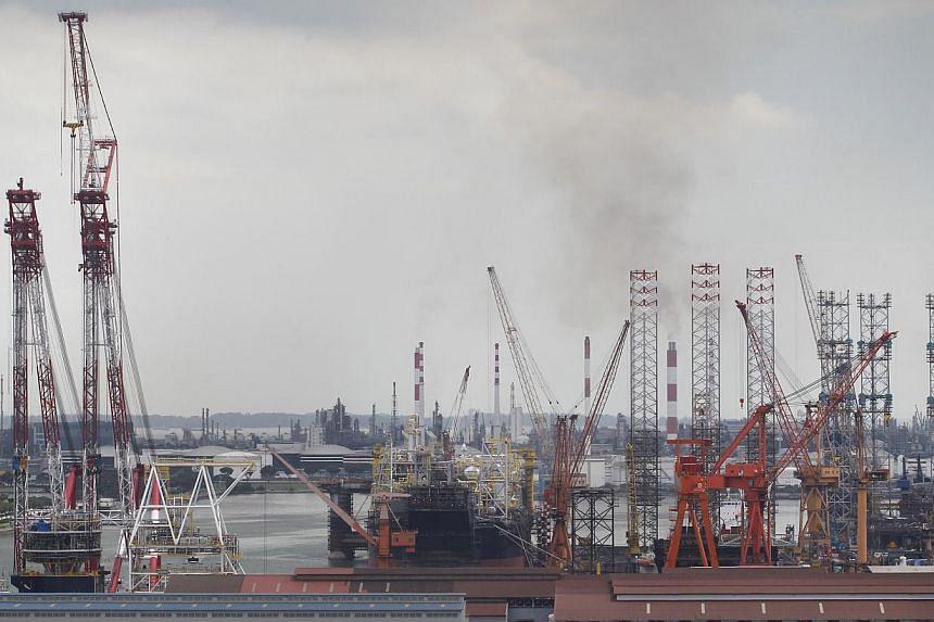 Oil rigs at Jurong Shipyard. -- ST PHOTO:KEVIN LIM
