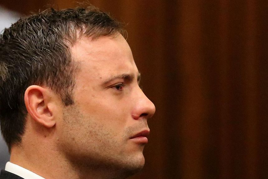 Fallen paralympic star Oscar Pistorius listens to the verdict in his trial at the high court in Pretoria on September 12 2014, in this file photo. He returns to court on Monday at the start of his sentencing hearing after he was convicted of culpable