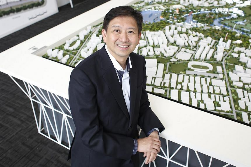 Managing partner of Evia Real Estate, Vincent Ong, 53, poses for a photograph at the Lake Life condominium showroom on Oct 3, 2014.Plans to jazz up the Jurong Lakeside district probably caused the overwhelming response to the Lake Life executiv