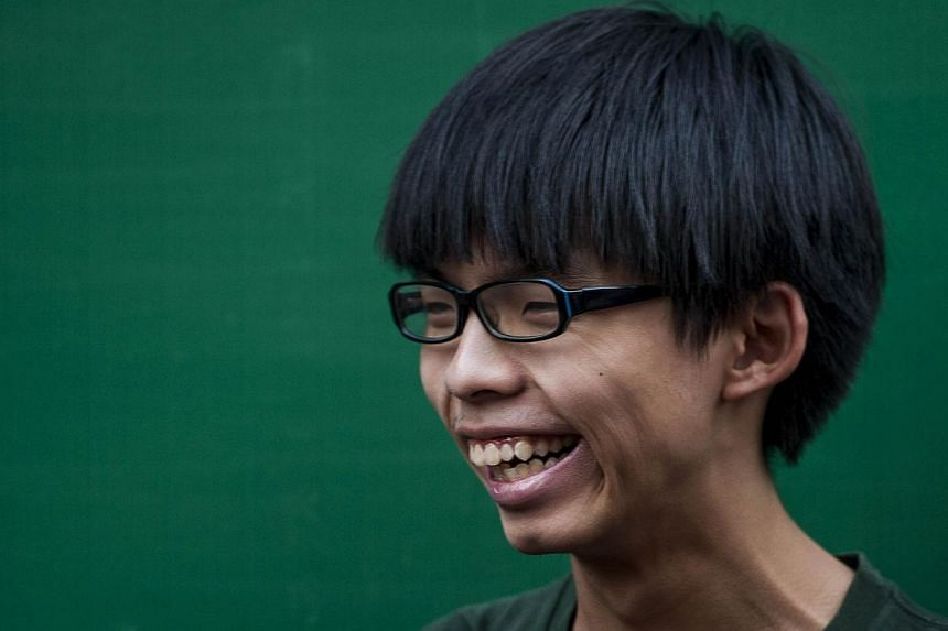Pro democracy activist Joshua Wong turned 18 and celebrated his birthday with fellow protesters and a Twitter photograph showed him with a cake in the shape of an umbrella, the symbol of the current protests. --PHOTO: AFP