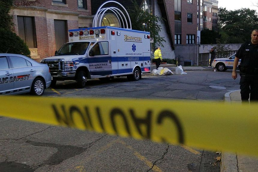 The ambulance used to transport a patient from Liberia with possible Ebola symptoms is parked outside the Beth Israel Deaconess Medical Center in Boston, Massachusetts on October 12, 2014. Doctors said on Monday that the patient did not have Ebola. -