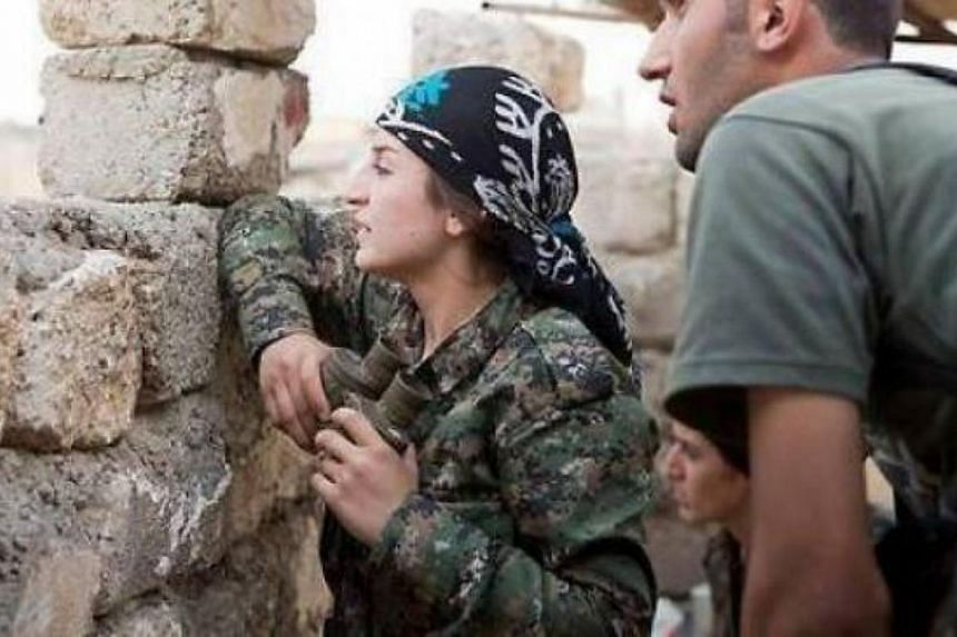 Kurdish woman commander Mayssa Abdo, 40, on the frontlines against ISIS fighters in Kobane. -- PHOTO: PRESS TV