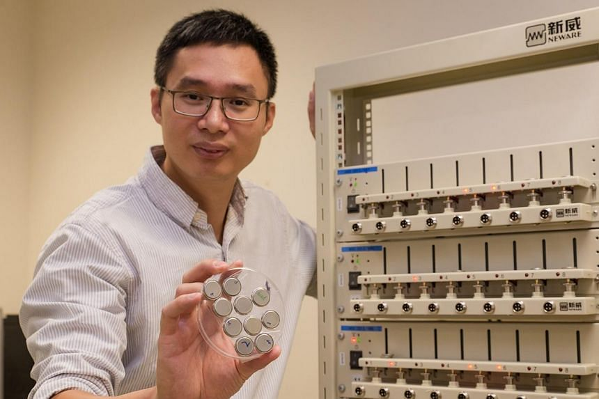 NTU Associate Professor Chen Xiaodong holding the ultra-fast rechargable batteries in his right hand, with the battery test station to his left.Nanyang Technological University (NTU) scientists have developed a battery that can be charged up to