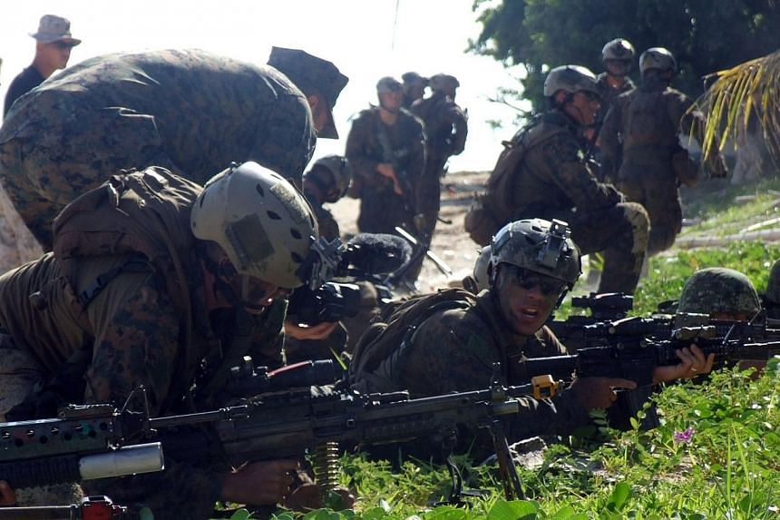 """Philippine and US marines take their positions during the annual joint naval exercise dubbed """"Phiblex"""" at an island near the south China sea in Puerto Princesa, Palawan island on Oct 2, 2014.Philippine authorities are investigating the possible"""