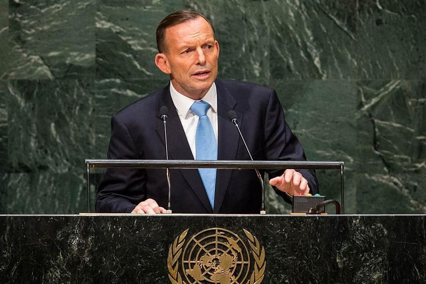 "Prime Minister of Australia Tony Abbott speaks at the 69th United Nations General Assembly on Sept 25, 2014 in New York City. Australian Prime Minister Tony Abbott on Monday vowed to ""shirtfront"", or confront, Russian President Vladimir Putin at"