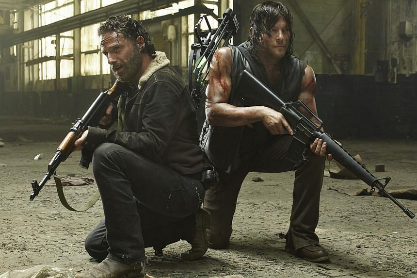 Main characters in The Walking Dead that are favourites with fans are played by Steven Yeun (left), Andrew Lincoln (above left) and Norman Reedus (above right).