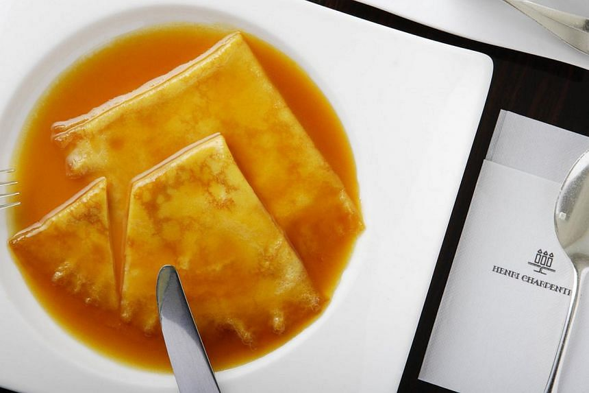Aside from its signature crepe suzette (left), Henri Charpentier also offers Les Financiers (below left) and lemon tart (bottom left).