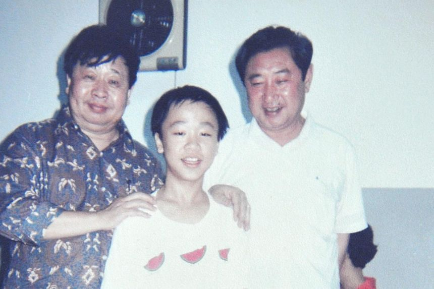 Chong as a student with the late Chinese crosstalk legend, Ma Ji (above left) and another crosstalk master, Zhao Shizhong, in 1990. -- PHOTO: COURTESY OF OLIVER CHONG