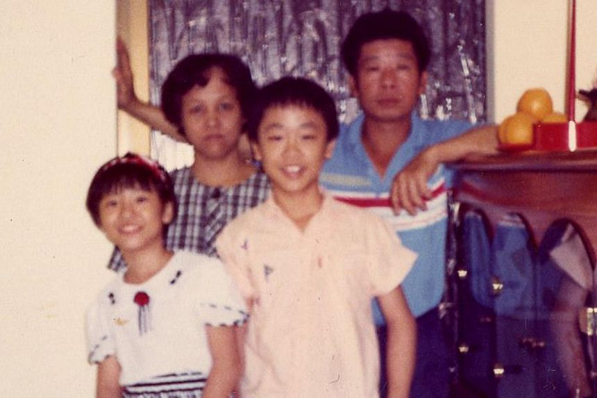 Oliver (above right) with his sister and parents. -- PHOTO: COURTESY OF OLIVER CHONG
