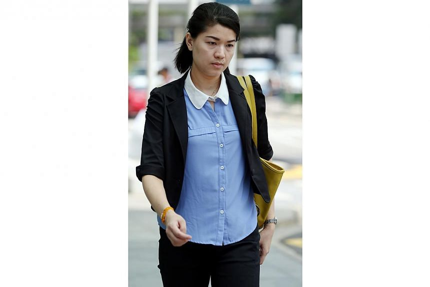 May Thu San Kyaw Nyein, 34, was fined $12,500 for maid abuse. -- ST PHOTO:WONG KWAI CHOW