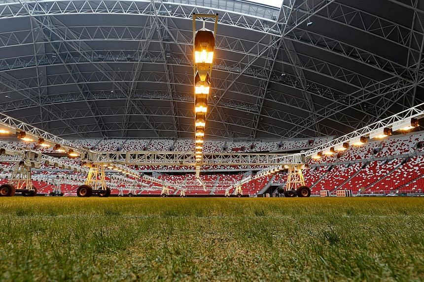 To stimulate the growth of its rye and blue grass seeds, $1.5 million worth of special lighting equipment was installed recently. The lights, hovering slightly over a metre above ground, are kept on through the night to act like sunlight. -- ST PHOTO